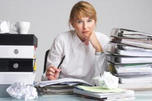 stressed-woman-at-work-paperwork_1-447x298